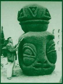 Azael José María Franco Guerrero and one of its 'living sculptures' in Tulcán Cemetery, Ecuador