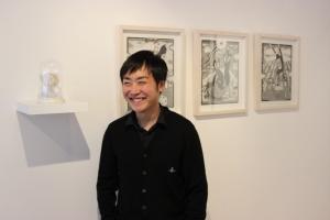 Takayuki Hara with his work